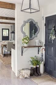 small entryway design with small floating shelf under decorative