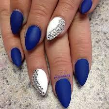 matte blue and white stiletto nails with rhinestones
