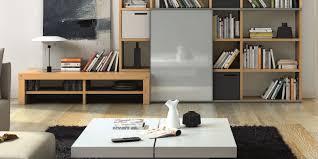 living room brown bookshelves hardwood floor nice black shaggy