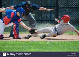 baseball player sliding into home plate stock photo royalty free