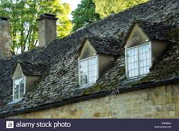 old dormer windows and tiled roof on cotswold cottages in
