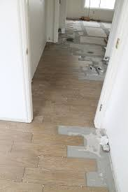 Faux Wood Laminate Flooring Tips For Achieving Realistic Faux Wood Tile Chris Loves Julia
