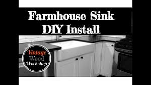 how to install farm sink in cabinet installing a kohler farmhouse sink diy how to kitchen remodel 4