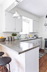 best 25 concrete kitchen countertops ideas on pinterest farm love the white cabinets polished concrete counters diy with ardex feather finish