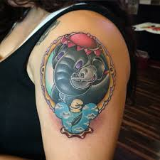impressive dumbo with mother tattoo on women left shoulder