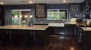 15079355 modern kitchen with dark wood cabinets and hardwood