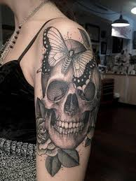 sugar skull tattoos design with butterfly and roses tatts