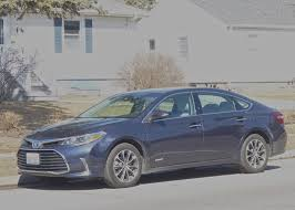 toyotas new car toyota hybrids range from avalon to prius trio new car picks