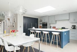 new england kitchen edmondson interiors bespoke kitchen design the furniture detail is a new england classic with a twist simple flat fronts with an applied bead highlighted by cleverly placed led lighting