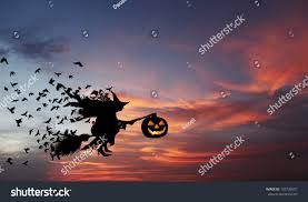 flying witch halloween silhouette witch flying on broomstick carrying stock photo