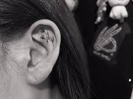 minimalist ear trend has getting tiny tattoos on ear