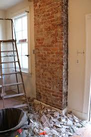 17 apart before u0026 after exposing a brick chimney under plaster walls