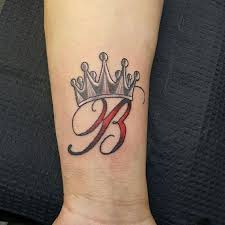 b letter with crown tattoo on wrist