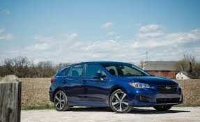 blue subaru hatchback 2017 subaru impreza in depth model review car and driver