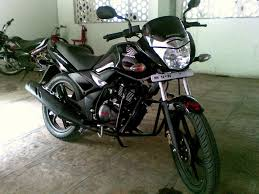 black honda bike honda unicorn when seconds do matter