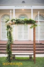 wedding arch leaves a varnished wood arbor for the wedding ceremony is asymmetrically