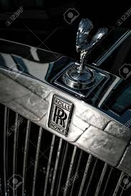 front of the rolls royce car with logo and the spirit of ecstasy