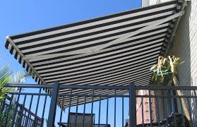 White Awning Black And White Awning Over Deck Rolltec Retractable Awnings