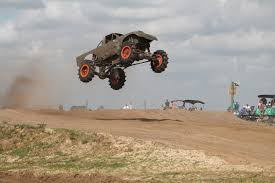 monster trucks racing in mud racing and pulls