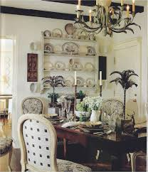 dining room with a few dark wood beams dark wood table white