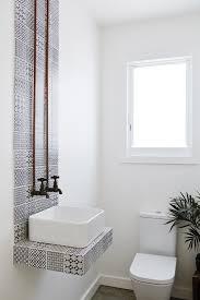 bathroom small bathroom design ideas with dark hardwood flooring