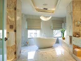 luxury bathroom bathtub doors with gray tile wall white vanity