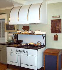 white and brass custom range hood www customrangehoods ca stove