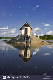 surrounded by high water a house with flood marker at the mouth
