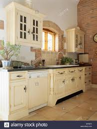 traditional cream country kitchen with dishwasher in fitted unit
