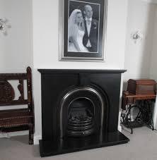 honed black granite fireplaces