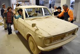 toyota co aichi volunteers carve wooden tribute to first toyota corolla