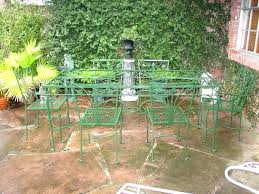 Patio Around Tree Black Wrought Iron Piano And Bench In A Flower Garden Antique