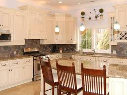 pictures of kitchens with antique white cabinets great kitchen antique white cabinets transitional with black subway