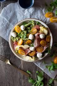 pesto pasta salad with artichokes proscuitto and mozzarella