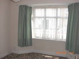Window Scarves For Large Windows Inspiration Uncategorized Hanging Curtains In Bay Window Within Inspiring