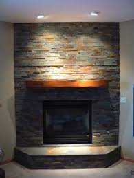 Stacked Stone Around Fireplace by Black Stack Stone Around Fire Place Google Search Renovations