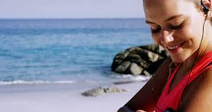 Hawaii travel man images Man texting using smart phone app on smartphone on hawaii beach jpg