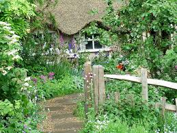 cottage garden ideas with small path and old style cottage and