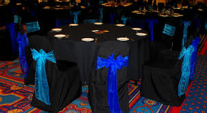 royal blue chair covers alternating turquoise and royal blue organza on black chair covers