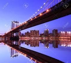 manhattan bridge and manhattan skyline at night lights nyc stock