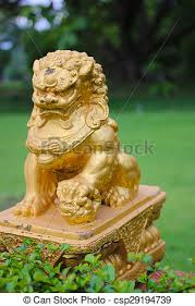 gold lion statue gold lion statue front the grass statue of a