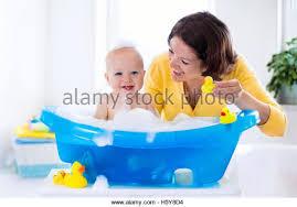 Mom In Bathtub Baby In Yellow Bath Tub Stock Photos U0026 Baby In Yellow Bath Tub
