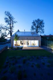 sqm small reinforced concrete house design with simple lawn garden