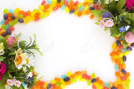 sweet and colorful jelly beans frame with easter flowers stock