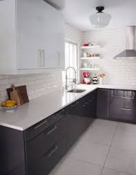 Black And White Kitchen Cabinets by Black Hardware Marbles White Bench And Black Cabinet
