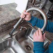 replace kitchen sink faucet to install a kitchen faucet