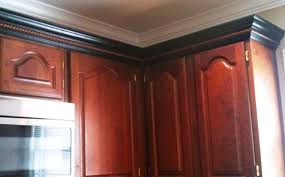 cherry cabinets black molding black crown molding kitchens in