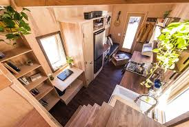 this tiny farm house on wheels starts at 63k downstairs bedroom