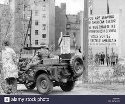 ww2 jeep side view a soldier of the us army in a jeep on the west berlin side and the
