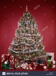 1970s evergreen tree on background decorations tinsel garland